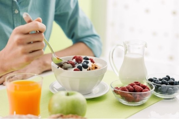Person enjoying a healthy breakfast while on a Profile by Sanford plan.