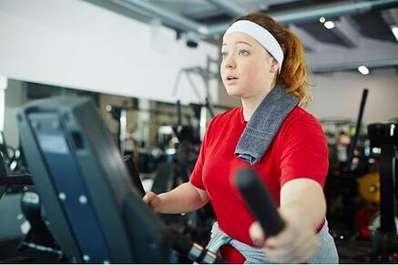 Woman working out on a treadmill.
