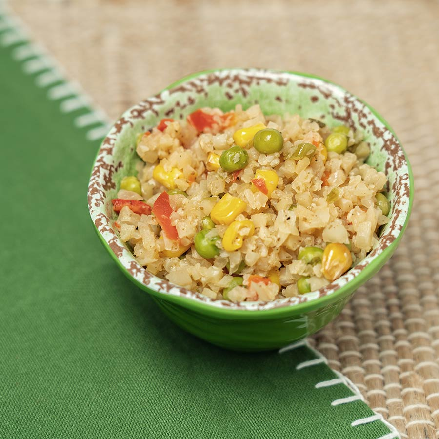 Small bowl of Cauliflower Fried Rice with peas and corn