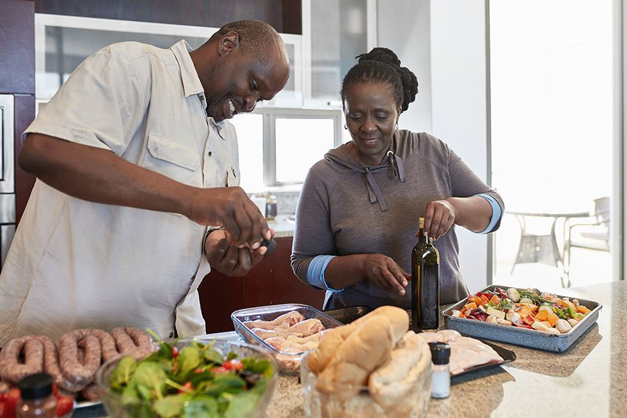 Couple preparing food in the kitchen for the balance Profile food plan.