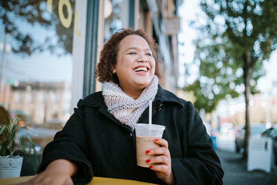 lady enjoying iced coffee
