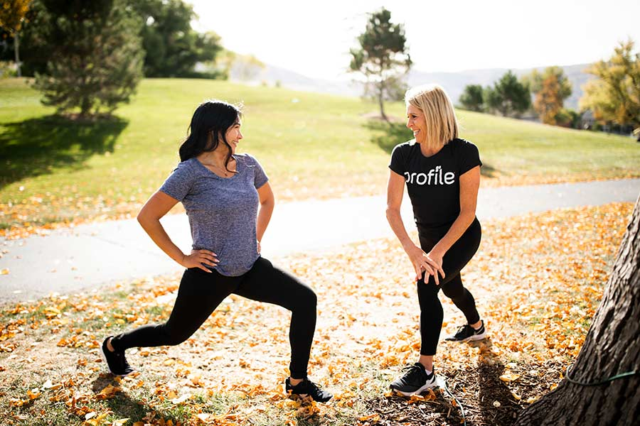 woman and coach stretching together, focusing on heart health