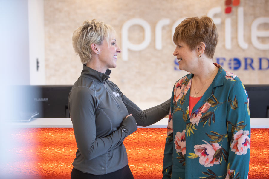 Profile by Sanford weight loss coach greeting a member for her coaching appointment.