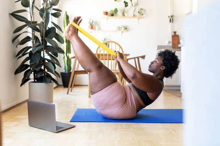 Woman working out to boost metabolism
